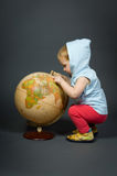 Cute little baby with globe Stock Photos