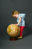 Cute little baby with globe royalty free stock photography