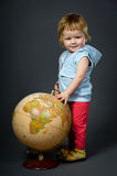 Cute little baby with globe Stock Images