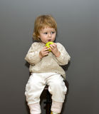 Cute little baby with green apple Stock Photos