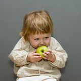 Cute little baby with green apple Royalty Free Stock Photo