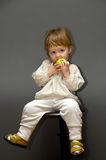 Cute little baby with green apple Royalty Free Stock Photos