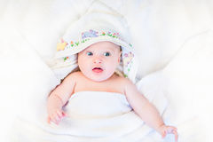 Cute little baby in hand made cross stitch towel Royalty Free Stock Photography