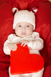 Cute little baby with heart Royalty Free Stock Photography