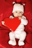 Cute little baby with heart Stock Photos