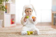 Cute Little Baby In Bunny Costume Playing At Home Stock Photos