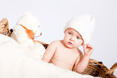 Cute little baby infant in basket with teddy Royalty Free Stock Photos