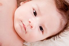 Cute little baby infant toddler on white blanket portrait Royalty Free Stock Images