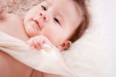 Cute little baby infant toddler on white blanket portrait Stock Image