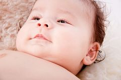 Cute little baby infant toddler on white blanket portrait Stock Photo