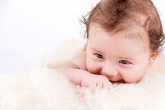 Cute little baby infant toddler on white blanket portrait Royalty Free Stock Photos