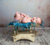Cute little baby with legs up on scales Stock Photo