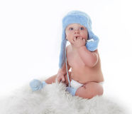 Cute little baby is looking and wearing blue hat Stock Photography