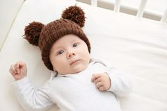 Cute little baby lying in cradle. At home Stock Photography