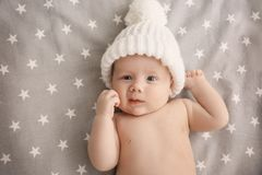 Cute little baby lying in cradle. At home Royalty Free Stock Photos