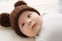Cute little baby lying in cradle at home,. Closeup Royalty Free Stock Image