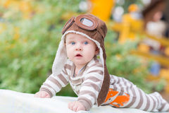 Cute little baby lying in the park Stock Images