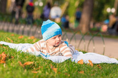 Cute little baby lying in the park Royalty Free Stock Image