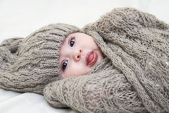 Cute little baby. Newborn baby girl in pink knitted hat. Newborn baby girl in pink knitted hat. Parenting or love concept royalty free stock photography