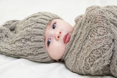 Cute little baby. Newborn baby girl in pink knitted hat. Parenting or love concept. Royalty Free Stock Images