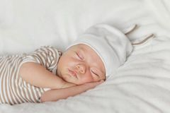 Cute little baby newborn sleeping at home.  Stock Photo