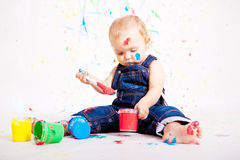 Cute little baby painting splatter colours Stock Photography
