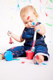 Cute little baby painting splatter colours Royalty Free Stock Image