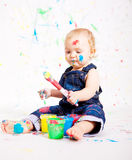 Cute little baby painting splatter colours Stock Photo