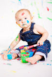 Cute little baby painting splatter colours Stock Image