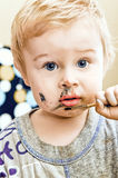 A cute little baby she paints Royalty Free Stock Photo
