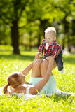 Cute little baby in the park with mother on the grass. Sweet bab Stock Photography