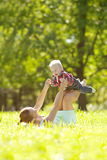 Cute little baby in the park with mother on the grass. Sweet bab Royalty Free Stock Photo