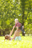 Cute little baby in the park with mother on the grass. Sweet bab Stock Image