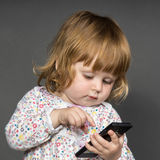 Cute little baby with phone Royalty Free Stock Photo