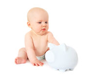 Cute little baby with piggy bank Royalty Free Stock Photography