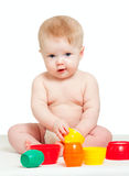 Cute little baby playing with color toys on white. Cute little baby is playing with color toys over white Stock Photo