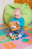 Cute little baby playing with colorful toys Royalty Free Stock Photography