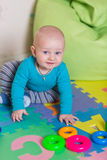 Cute little baby playing with colorful toys Stock Photo
