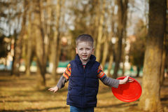 Cute little baby  playing frisbee, oudoor Stock Images