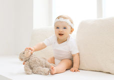 Cute little baby playing with toy at home in white room Royalty Free Stock Photos