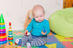 Cute Little Baby Playing With Colorful Toys Royalty Free Stock Image