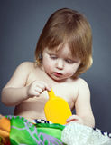 Cute little baby posing in studio. Stock Photo