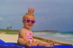 Cute little baby princess on summer beach Stock Photos