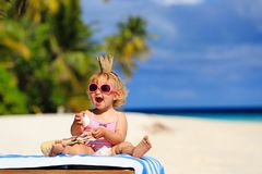 Cute little baby princess on summer beach Stock Images