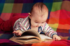 Cute little baby reading book Stock Photos