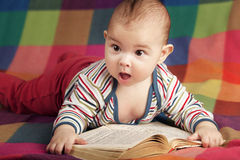 Cute little baby reading book Royalty Free Stock Photography