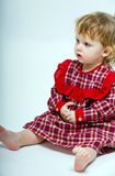 Cute little baby in red dress Stock Image