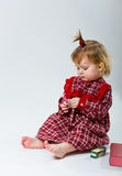 Cute little baby in red dress Royalty Free Stock Images