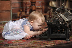 Cute little baby with retro style typewriter stock photos