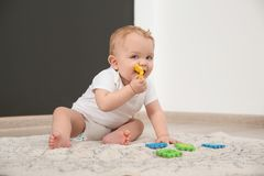 Cute little baby on rug. Crawling time royalty free stock photography
